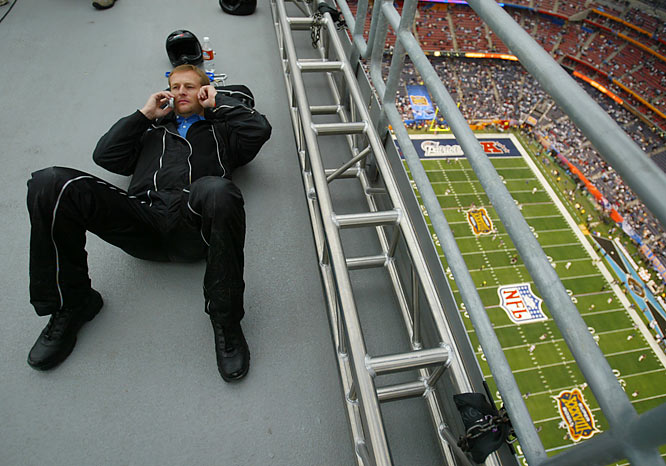 A parachuter relaxes in the catwalk just prior to his performance in Super Bowl XXXVIII.