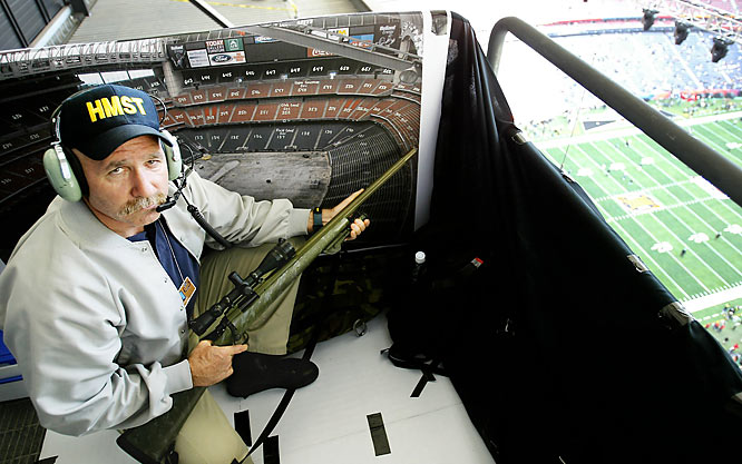 A member of the Houston Municipal Swat Team has an over-the-top view of Super Bowl XXXVIII at Reliant Stadium.