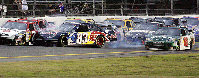...then, Junior clips Brian Vickers, triggering a nine-car wreck.
