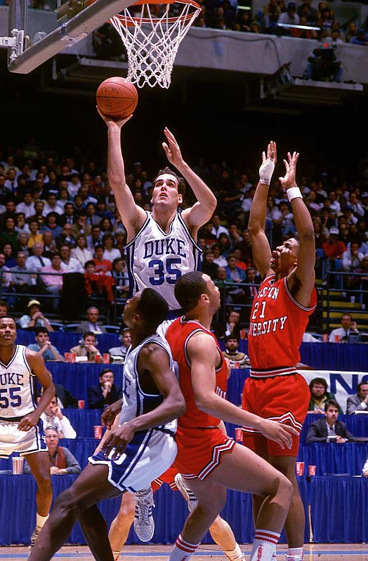 Danny Ferry drives in for a layup during the 1988  Eastern Regional against BU. In four seasons in Durham, Ferry thrice led the Blue Devils to the Final Four.