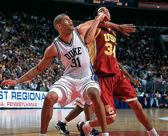 Shane Battier battles USC's David Bluthenthal for position during the Elite Eight round of the 2001 NCAA Tournament.