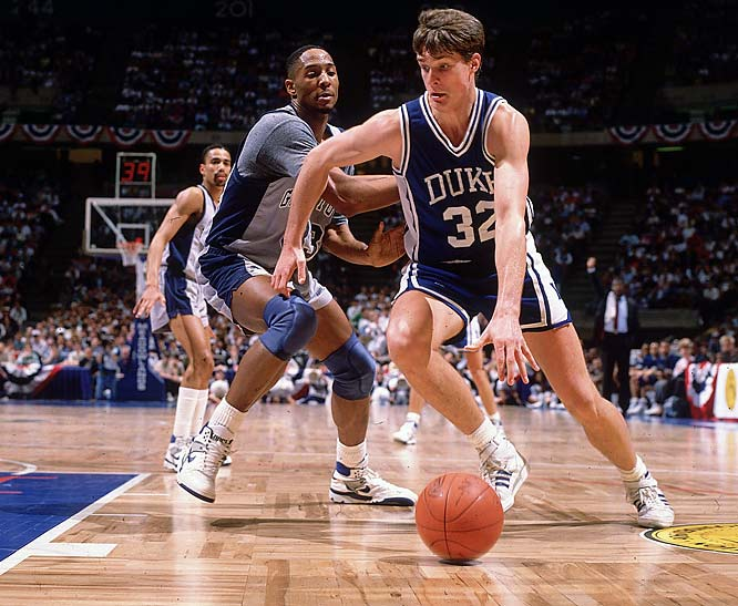 Christian Laettner dribbles past Georgetown's Alonzo Mourning during the 1989 Regional Final in East Rutherford, N.J.