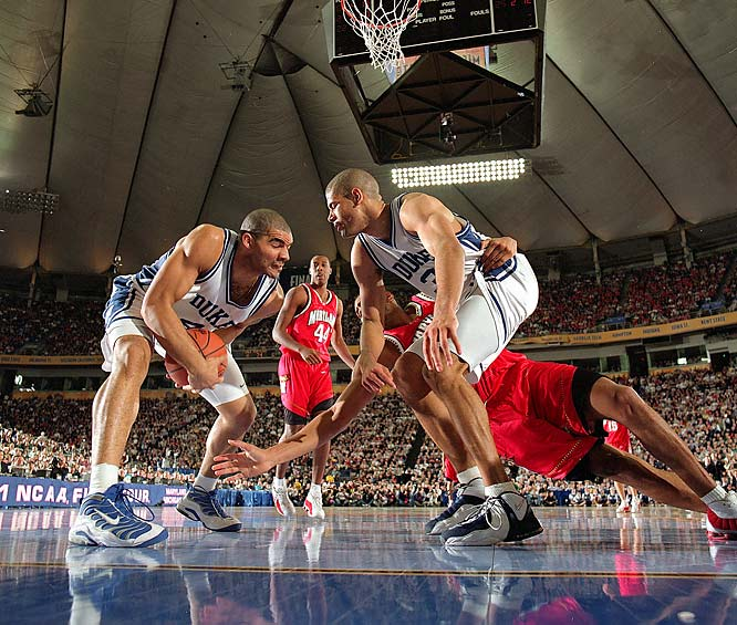 Carlos Boozer grabs a loose ball in front of teammate Shane Battier during the Final Four of the 2001 NCAA Tournament.