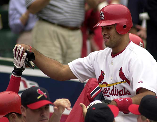 Avoiding an arbitration hearing, the Cardinals and Albert Pujols agree to a $100 million, seven-year deal.