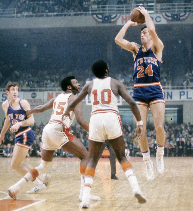 Bill Bradley shoots a jumper over a pair of Washington defenders. The former New Jersey senator spent 10 years as a member of the Knicks and was elected to the Basketball Hall of Fame in 1982.