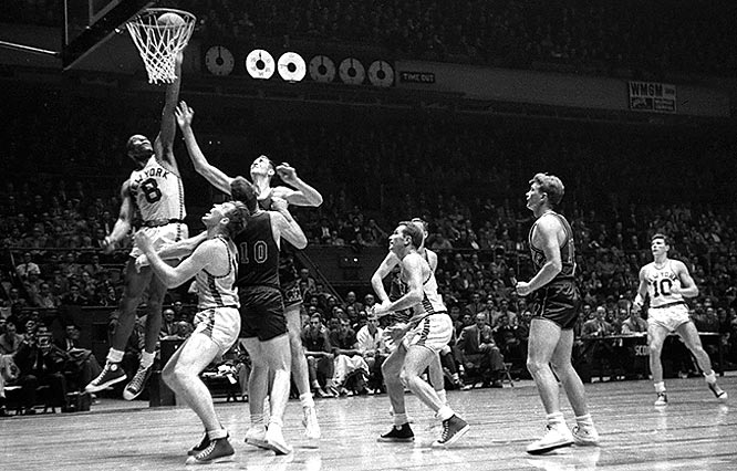 """Knicks forward Nat """"Sweetwater"""" Clifton puts back a rebound during a game against the Rochester Royals."""