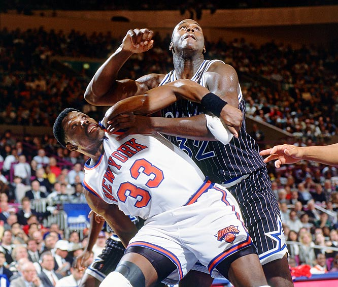 Patrick Ewing and Shaquille O'Neal battle for a rebound.