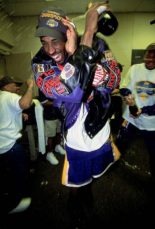 Kobe Bryant celebrates his second championship after the Lakers beat the Sixers in five games.