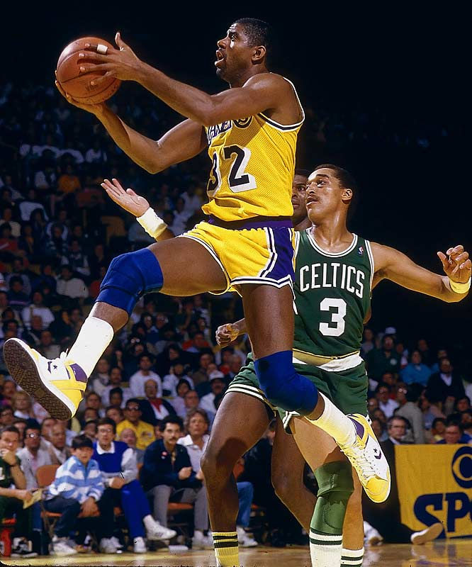 Magic Johnson glides past Dennis Johnson during a Celtics-Lakers regular season matchup.