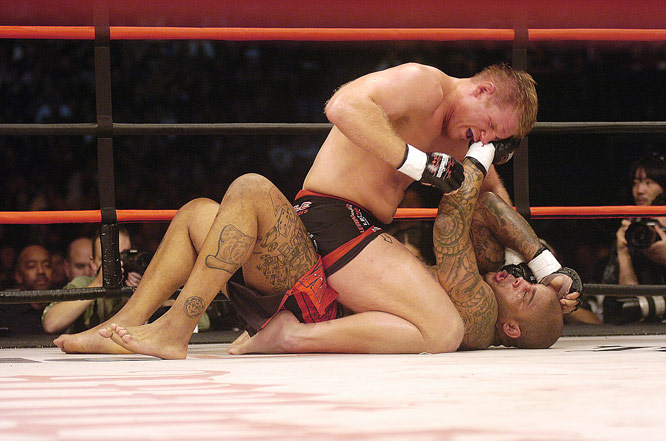 "After becoming the youngest UFC heavyweight champion in 2002 (he defeated Randy Couture), Josh Barnett (top) has won nine fights via submission. The latest was against Gilbert Yvel (bottom) at Affliction's ""Day of Reckoning."""