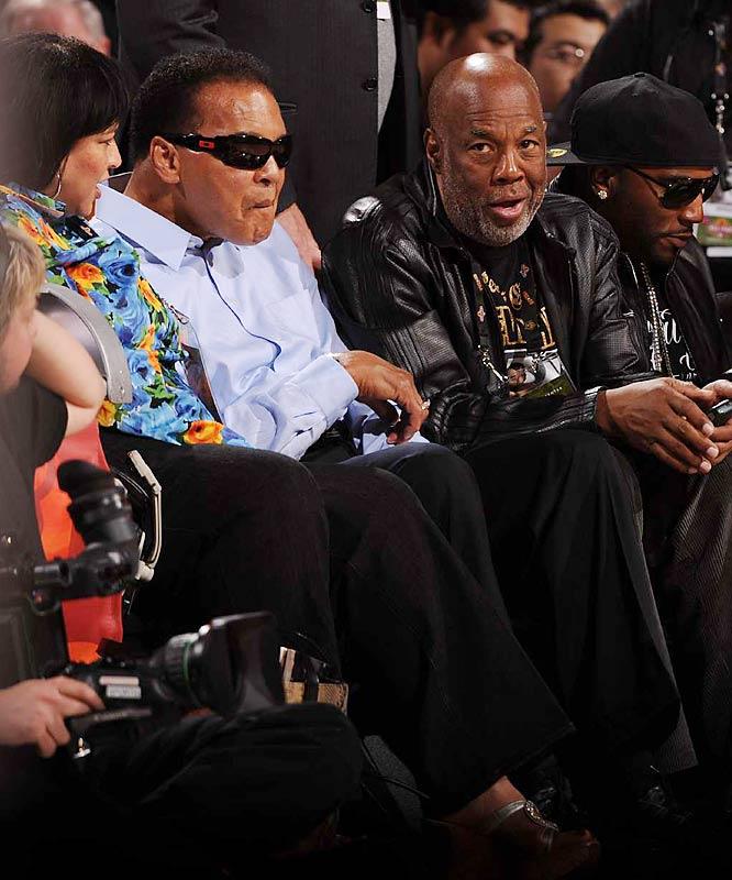 ... and Muhammad Ali with his biographer Howard Bingham.