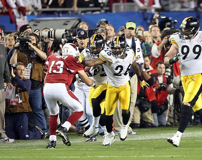 Arizona quarterback Kurt Warner does his best to stop the Pittsburgh convoy.