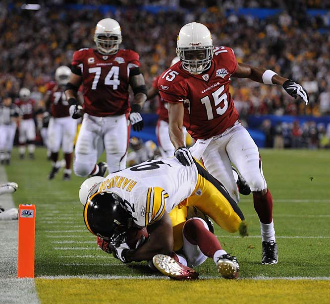 As Harrison falls, his knee lands on Fitzgerald's thigh instead of the ground.