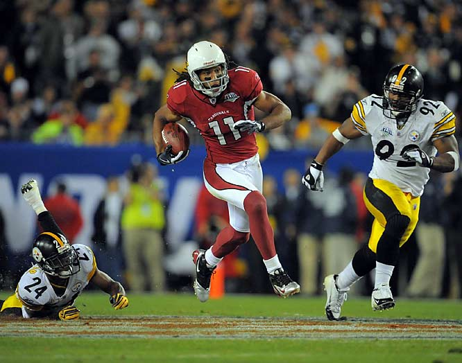 Larry Fitzgerald caught the ball in the middle of the field, avoided a tackle and outran the Pittsburgh safeties for his second TD of the game.