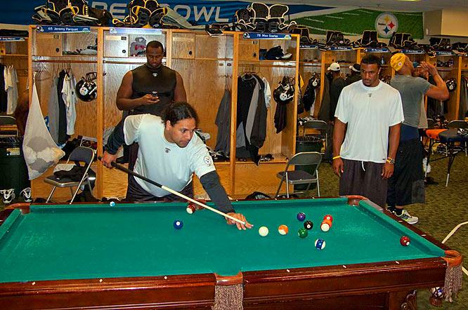 Pittsburgh quarterback Ben Roethlisberger and SI photographer Michael J. LeBrecht II teamed up to take these behind-the-scenes shots at Super Bowl XLIII.<br><br>Pittsburgh safety Troy Polamalu plays pool during a break in the locker room of the Steelers' practice facility at the University of South Florida.