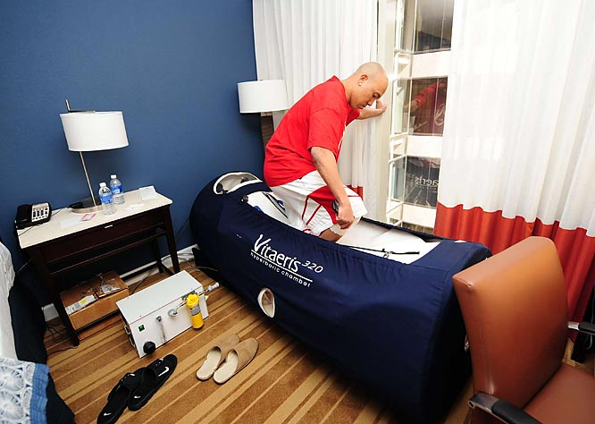 Hines Ward enters the hyperbaric chamber in his hotel room to treat an injury in the days leading up to the game.