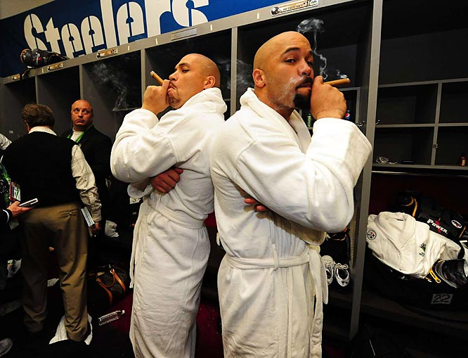 James Farrior (left) and Larry Foote smoking victory cigars.