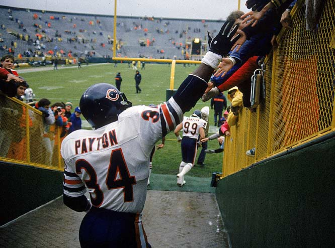 Payton won the league's MVP award in 1977 when he ran for 1,852 yards and scored 16 touchdowns. Shown here walking onto Lambeau Field, Payton's biggest game of '77 came against the Vikings, when he rushed for a then-record 275 yards while battling the flu.