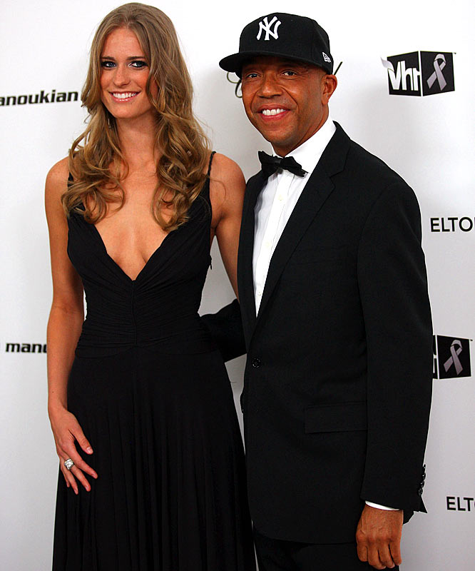 "Probably the most mismatched couple on Oscar night was the surprising duo of Julie Henderson and Russell Simmons. The 22-year-old SI Swimsuit model and the 51-year-old music mogul were arm in arm as they walked down the red carpet at the ""Vanity Fair"" and Elton John Oscar parties."