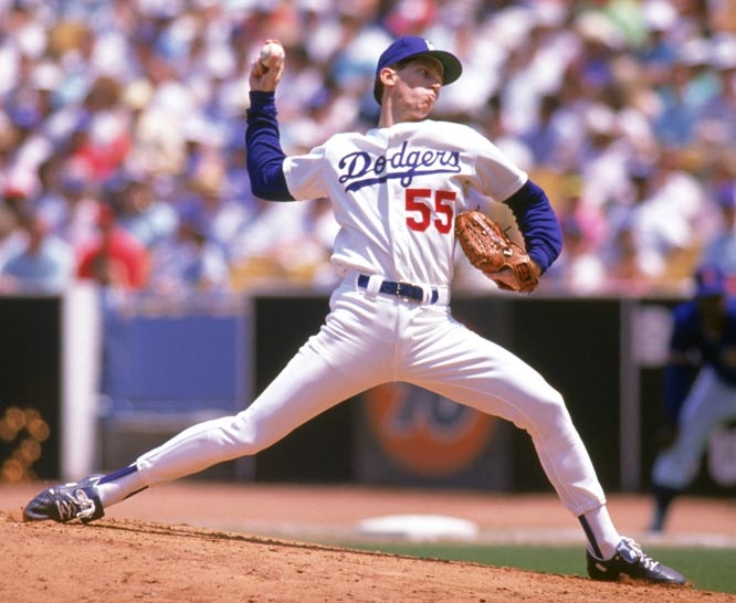 After leading the Dodgers to a World Series championship, Orel Hershiser signs a record $7.9 million, three-year contract.