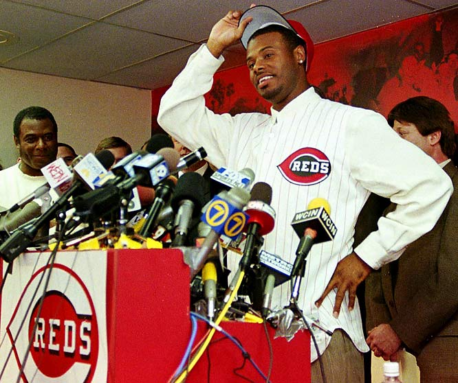 The Reds send four players -- pitcher Brett Tomko, outfielder Mike Cameron and two minor leaguers -- to the Mariners in exchange for outfielder Ken Griffey Jr.