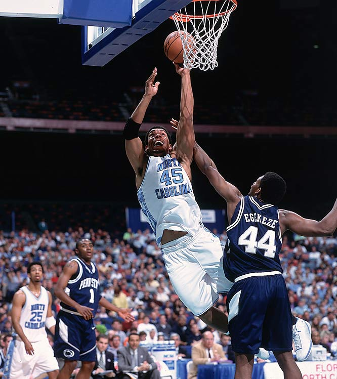 Julius Peppers attempts a layup over a Penn State defender during Round 2 of the NCAA Tournament. Peppers, who also played football for the Tar Heels, went on to become an NFL standout.