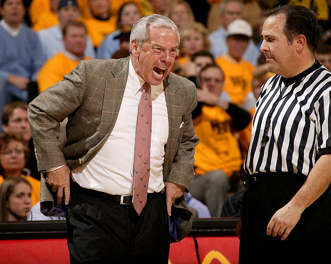 Coach Roy Williams exchanges pleasantries with a referee during a game against Wake Forest.
