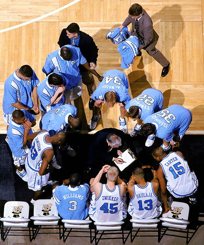 Dean Smith draws up a play during a second-round NCAA Tournament game against Colorado.