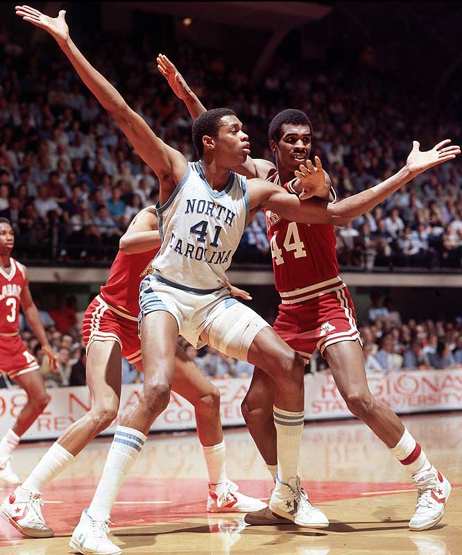 Sam Perkins posts up against Houston.