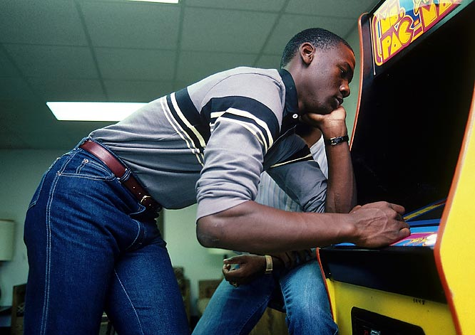 Michael Jordan enjoys some down time by playing a game of Ms. Pac-Man.