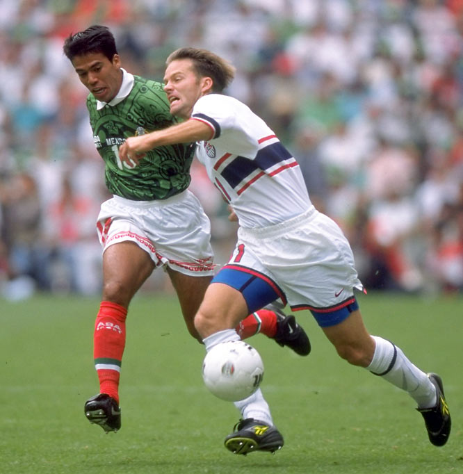 "The U.S. had heard enough of its 17-game losing streak -- and 69-13 combined score line -- at the Azteca. Down a man for most of the game, Eric Wynalda (at right) and the Americans muscled out a point in front of more than 100,000 feverish Mexican fans. The result qualified Mexico for the '98 World Cup, but it didn't feel like it, as the stadium echoed with chants calling for the ouster of national-team coach Bora Milutinovic. ""We consider this a golden point,'' said a beaming U.S. coach Steve Sampson."