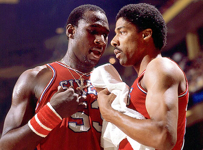 Darryl Dawkins and Julius Erving use a break in the game to discuss strategy.