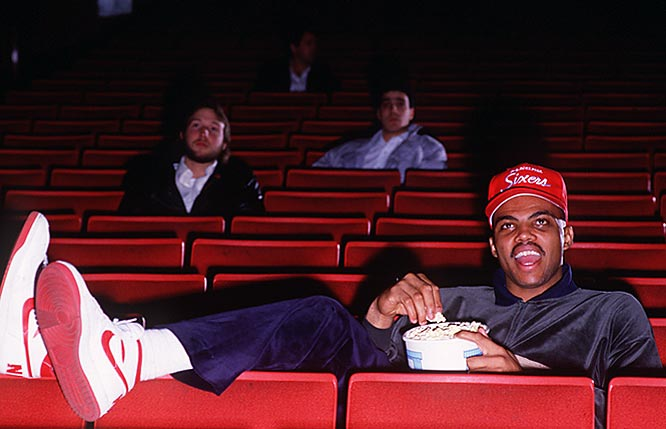 Charles Barkley pretends to enjoys some downtime at a photoshoot inside a Philadelphia movie theater.