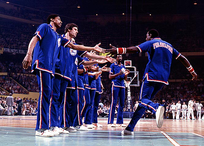 Darryl Dawkins joins his teammates on the court during team introductions at the Boston Garden.