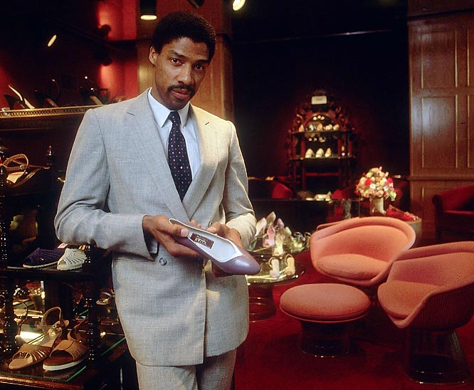 Julius Erving looks slick, but we're unsure why he's holding a woman's shoe.