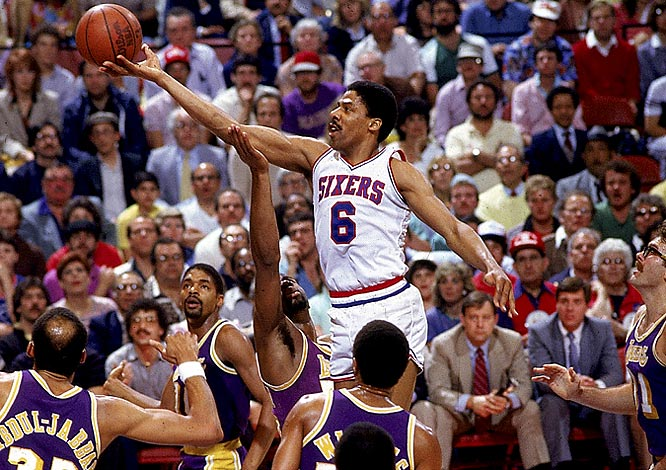 Julius Erving swoops in for a layup against the Lakers.