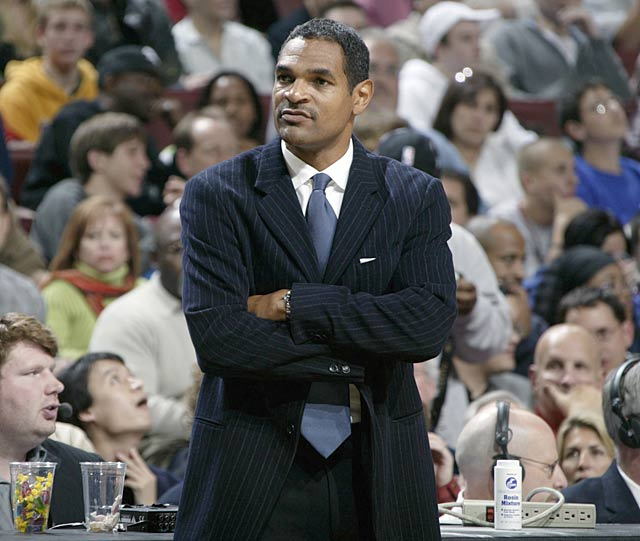 Coach Maurice Cheeks checks out the action.