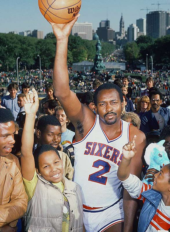 As this photo illustrates, Moses Malone was quite popular in Philadelphia.