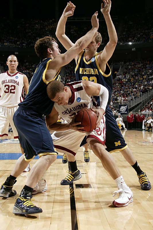 Bulling through double teams and soaring in for vicious dunks, Griffin powered Oklahoma over Michigan.