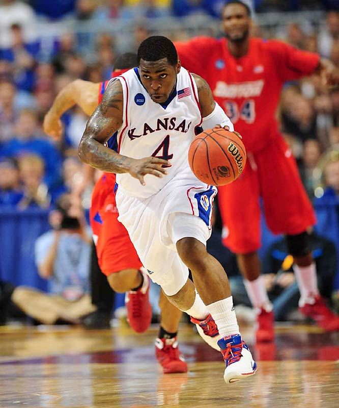 Sherron Collins had 25 points to help lead the defending NCAA champion past 11th-seeded Dayton.