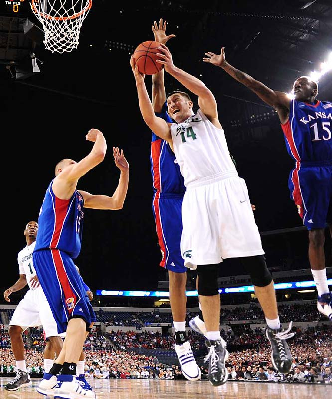 Goran Suton scored 20 points and Michigan State was steady from the foul line, defeating defending NCAA champion Kansas.