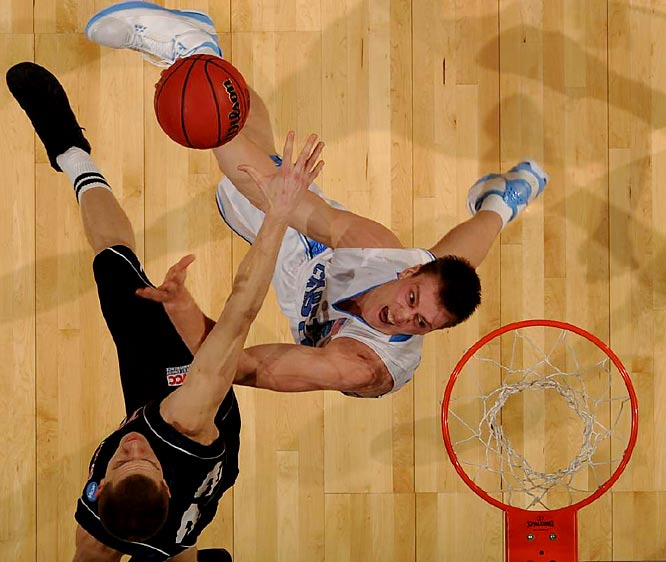Tyler Hansbrough added 24 points and 10 rebounds for North Carolina, which won its 99th NCAA tournament game, breaking a tie with Kentucky for the most by any school.