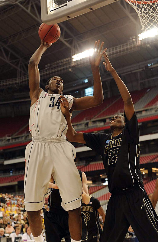 Hasheem Thabeet, the Big East player of the year, scored 15 points, had 15 rebonds and blocked four shots, and Connecticut overcame a sluggish first half to defeat Purdue.