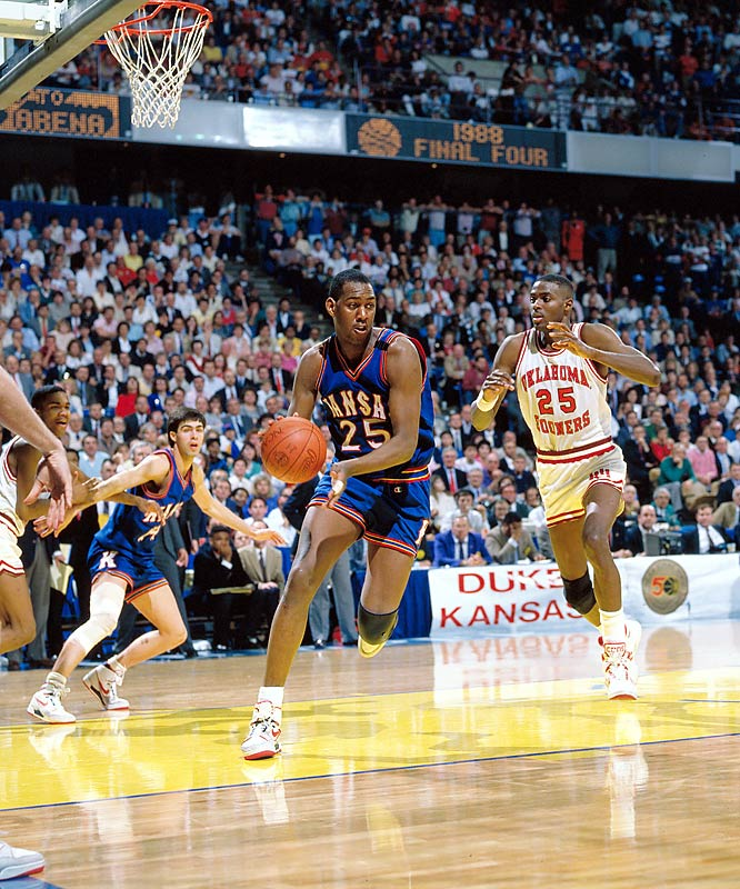 Oklahoma forward Harvey Grant tries to catch up with Kansas forward Danny Manning during the championship game in Kansas City. Kansas defeated Oklahoma 83-79; Manning was named tournament MVP.