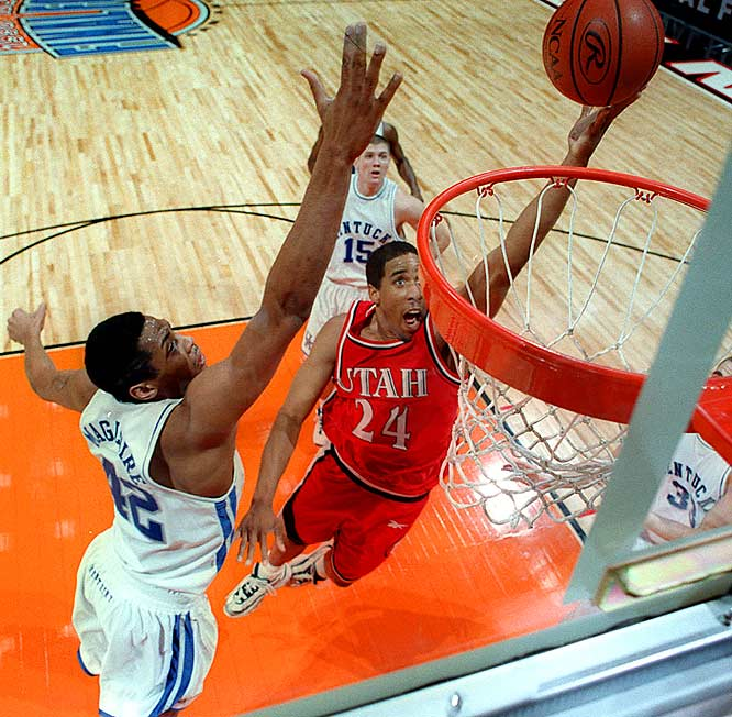Utah guard Andre Miller gets past Kentucky center Jamaal Magloire in San Antonio. Kentucky ultimately prevailed 78-69 for the title.