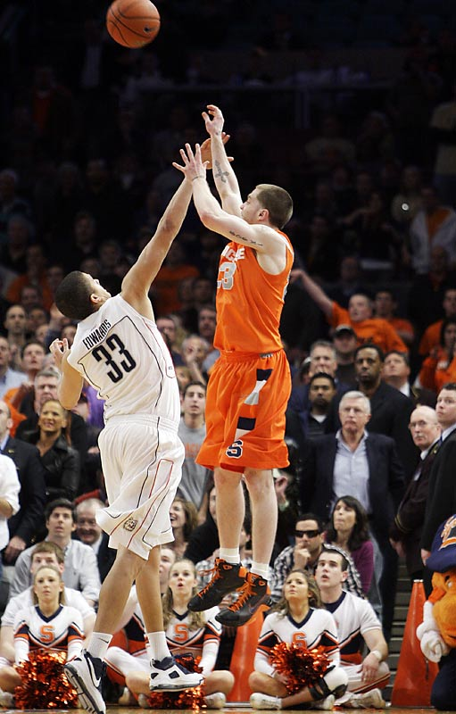 Eric Devendorf hit a shot at the buzzer -- then jumped on the scorer's table thinking Syracuse won 74-71.  The referee said the shot hit after the buzzer, thus beginning the six-overtime ending to one of the greatest Big East tournament games.