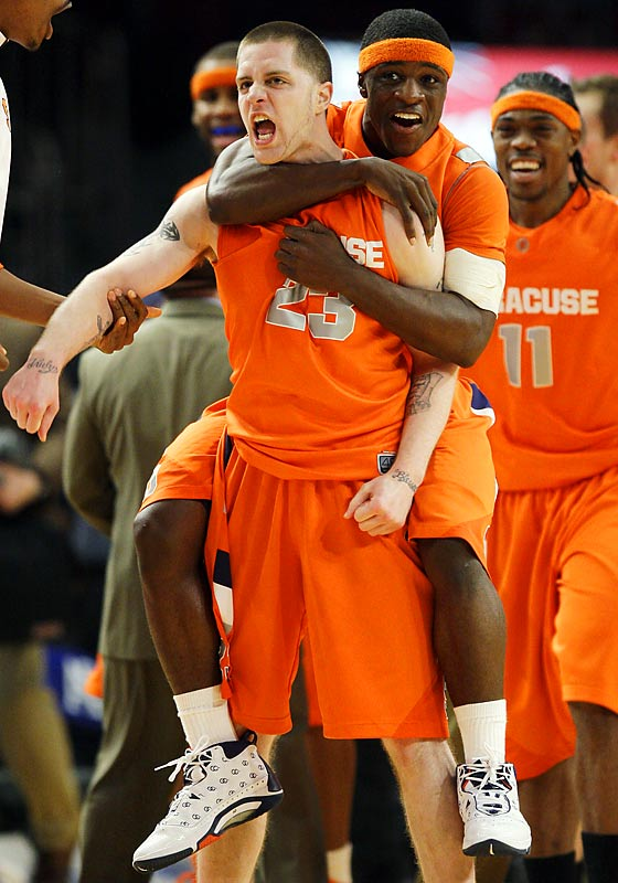 Jonny Flynn, right, played 67 minutes for the Orange.