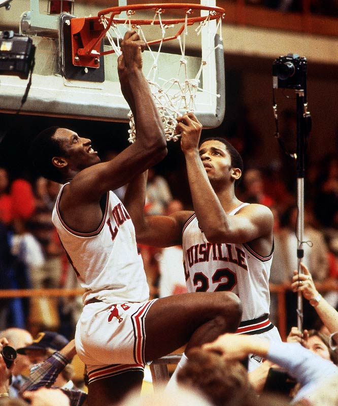 Louisville's Rodney McCray (No. 22) and Lancaster Gordon cut down the net after the Cardinals defeated Kentucky to advance to the Final Four.