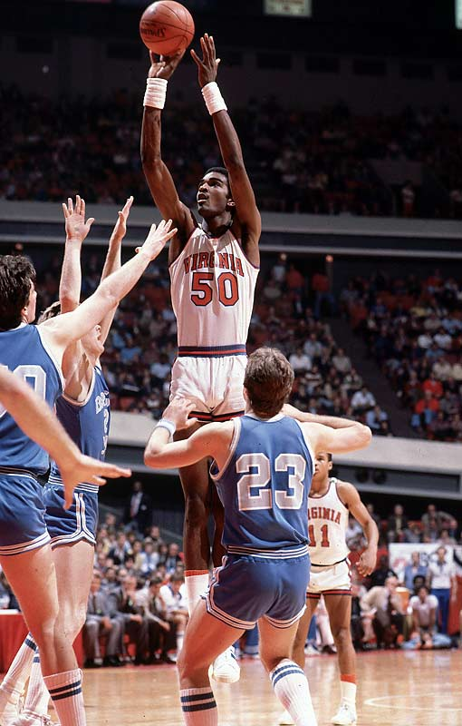 Virginia's 7-foot-4 center Ralph Sampson gets off a shot against Brigham Young.