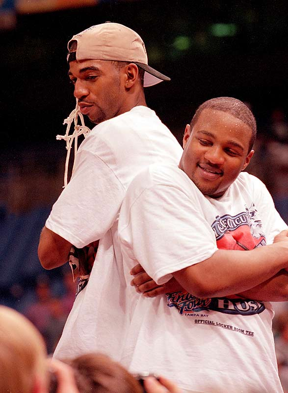 UConn's Richard Hamilton and Khalid El-Amin pose in celebration after beating Duke for the national championship.